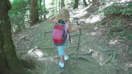 Stock Video Footage of POV of Child Hiking in Mountains, Tourist Girl Walking, Climbing Path in Forest