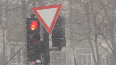 Car Waiting at Traffic Light on Blizzard Snowstorm Day , Heavy Snowing in Winter Stock Footage