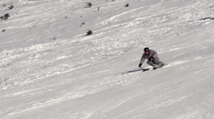 Slow Motion Of Skier Carving Down The Ski Slope Stock Footage