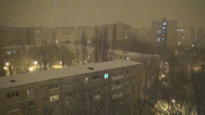 Stock Video Footage of Snowing in Night, Snow Fall, Christmas Scene, Winter View in Town, District