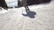 Stock Video Footage of Slow-Mo: Rear View Of Skier Carving Down Steep Slope