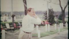 847 - a golfer sharpens his skill at the driving range - vintage film home movie Stock Footage