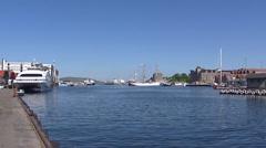 BERGEN, NORWAY: Ships, harbor in fjord + pan port building Stock Footage