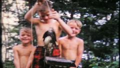 836 - brothers show off their catch - vintage film home movie Stock Footage
