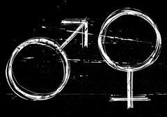 Male and  female symbols on black grunge background. Stock Illustration