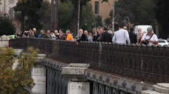 People on the bridge, Rome, Italy, Tiber, closeup Stock Footage
