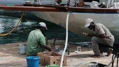 Antigua Island dock workers repair luxury yacht marina HD 1175 Stock Footage