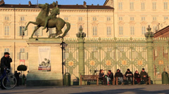 Man pushes bike past the residence of the House of Savoy in Torino Stock Footage