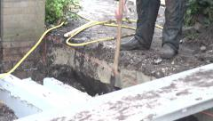 Man digging builing foundation Stock Footage