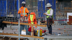 Construction workers ready to start evening shift at construction site Stock Footage