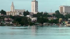 Guadeloupe Pointe-á-Pitre 073 buildings of city behind smooth water surface Stock Footage