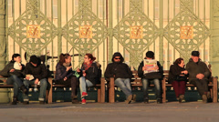 Italians sat in Torino piazza Stock Footage