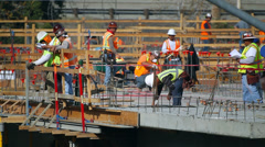 Construction manager discusses development documentation with the workers Stock Footage