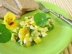 Scrambled eggs with herbs Stock Photos