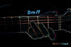 Guitar chord on a dark background Stock Illustration