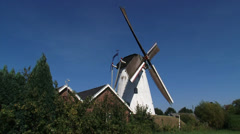 Dutch Windmill Type Beltmolen turning counterclockwise - side view Stock Footage