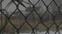 Chain Link Fence, Suburbs, Cloudy Day, Winter Stock Footage