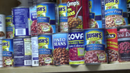 Stock Video Footage of Zoom out of food pantry shelves
