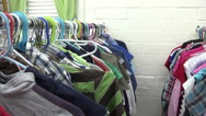 Stock Video Footage of Clothes at a cloths closet charity