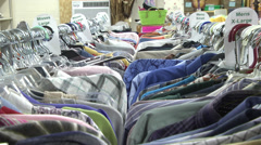 Clothes on hangers in racks Stock Footage