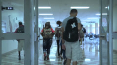 Anonymous students walking through a hallway - stock footage