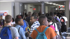 close up of Anonymous students walking through a hallway - stock footage