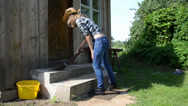Stock Video Footage of cowgirl sweep broom stair