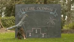 "Girl Cartwheels In Front of A Chalkboard with ""Future Olympian"" & Podium On It - stock footage"