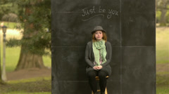 "Eccentric Woman Making Faces In Front Of Chalkboard ""Just Be You"" Sign Stock Footage"