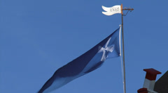 Blue mill flag waving in blue sky, wicks turning Stock Footage