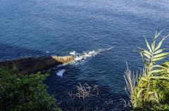Splashing waves from the Atlantic ocean in the rocks. Stock Photos