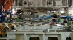 Press machine in automobile factory - stock footage