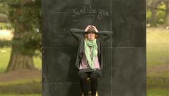 "Woman Goofing Around In Front Of Chalkboard ""Just Be You"" Stock Footage"