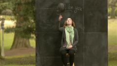 "Woman Tosses Up, Drops Hat In Front Of A Chalkboard ""Just Be You"" Sign Stock Footage"