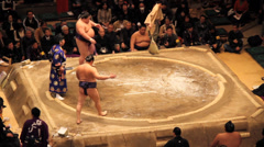 Sumo Stepping into Ring - stock footage