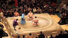 Sumo Competiton with Camera Flashes for Winner Stock Footage