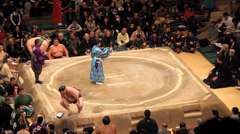 Sumo Wrestlers Purifying Ring with Salt before Bout - stock footage