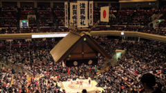 Sumo Competiton Venue View of Banners and Japanese Flag - stock footage