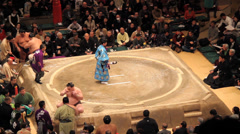 Sumo Official in traditonal Japanese Attire Blessing Ring - stock footage