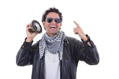 Man in a leather jacket with speaker Stock Photos