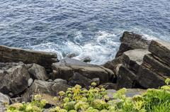 Splashing waves from the Atlantic ocean in the rocks. - stock photo