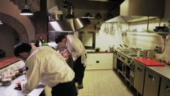 Chefs working in professional kitchen Stock Footage