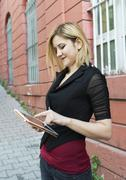 Cheerful Pretty Woman Holding Her Tablet Pc Outside Stock Photos