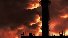 Dramatic red Smoke from industrial pipe against setting sun. Stock Footage