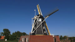 Eltmolen-type windmill on artificial mound with large loading doors in the base Stock Footage