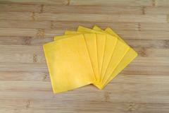 Sliced cheddar cheese Stock Photos