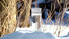 Freezing glass of water in real time. Stock Footage