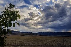 Very dramatic sky over the Navarra's fields - stock photo