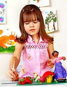 Child  moulding of plasticine . Stock Photos