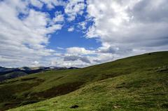 Beautiful view from the mountain, with impressive cloudscape and environment. - stock photo